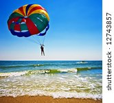 One Man Is Parasailing Over Th...