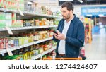 at the supermarket  handsome... | Shutterstock . vector #1274424607