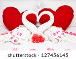 red heart pillows and two towel ... | Shutterstock . vector #127456145