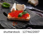 red caviar with bread on the... | Shutterstock . vector #1274622007