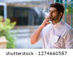 young handsome bearded indian... | Shutterstock . vector #1274660587