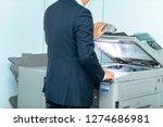 a businessman operating a copy... | Shutterstock . vector #1274686981