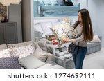 customer woman buying new... | Shutterstock . vector #1274692111