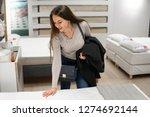 customer woman buying new... | Shutterstock . vector #1274692144