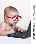 funny kid with a laptop | Shutterstock . vector #127479227