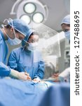 concentrated surgeons operating ... | Shutterstock . vector #127488695