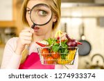 woman using magnifying glass... | Shutterstock . vector #1274933374