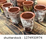 handmade coffe mugs made by clay | Shutterstock . vector #1274933974