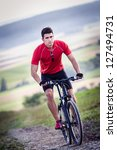 young man cycling cross country | Shutterstock . vector #127494731