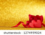 Two Decorative Hearts And Red...