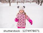 kid girl 5 6 year old holding...   Shutterstock . vector #1274978071