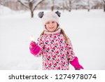 kid girl 5 6 year old holding...   Shutterstock . vector #1274978074