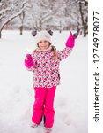 kid girl 5 6 year old holding...   Shutterstock . vector #1274978077