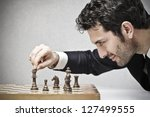 young business man playing chess | Shutterstock . vector #127499555