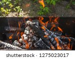 fire and firewood in a burning... | Shutterstock . vector #1275023017