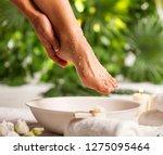 Female Feet With Sea Salt On...