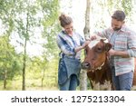 smiling couple standing with...   Shutterstock . vector #1275213304