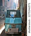 ape car blue parked italian... | Shutterstock . vector #1275246571
