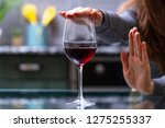 woman refuses to drink a... | Shutterstock . vector #1275255337