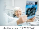 happy elder woman during the... | Shutterstock . vector #1275278671