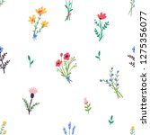 Seamless pattern. Simple flowers. Bouquets of wildflowers. Flower meadow. Hand drawn illustration.