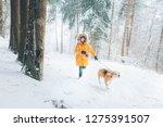 boy in bright yellow parka... | Shutterstock . vector #1275391507