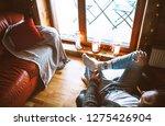 man sitting in comfortable... | Shutterstock . vector #1275426904
