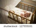 adorable baby asleep in his... | Shutterstock . vector #127555331