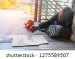 homeless man is lie down on... | Shutterstock . vector #1275589507