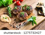 spicy grilled meat on rustic... | Shutterstock . vector #1275732427