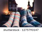 cozy woolen socks. couple...   Shutterstock . vector #1275793147