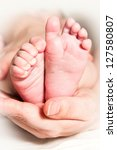 mother and baby feet   Shutterstock . vector #127580807