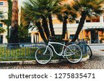 classic bicycle in downtown... | Shutterstock . vector #1275835471