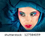 Fine art portrait of woman with colorful makeup in blue turban (looking away) - stock photo