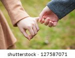 two female teens hold hand... | Shutterstock . vector #127587071