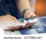 selective focus phone in hand... | Shutterstock . vector #1275881167