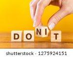 woman hand flip wooden cube... | Shutterstock . vector #1275924151