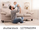 friendship of father and son.... | Shutterstock . vector #1275960394