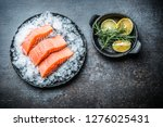 Portioned Raw Salmon Fillets In ...