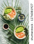 poke bowl with salmon rice and... | Shutterstock . vector #1276081927