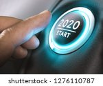 Small photo of Finger about to press a car ignition button with the text 2020 start. Year two thousand and twenty concept.