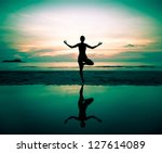 silhouette of a beautiful yoga... | Shutterstock . vector #127614089