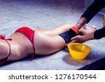 young woman in red bikini...   Shutterstock . vector #1276170544