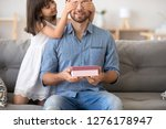 child daughter presenting gift... | Shutterstock . vector #1276178947
