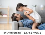 happy dad and playful cute kid... | Shutterstock . vector #1276179031