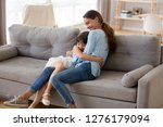 happy mother hugging cute... | Shutterstock . vector #1276179094