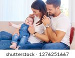 shot of happy young family... | Shutterstock . vector #1276251667
