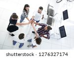 team of young designers shows... | Shutterstock . vector #1276327174