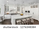 beautiful white kitchen in new... | Shutterstock . vector #1276348384