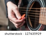 Female Hand Playing Acoustic...